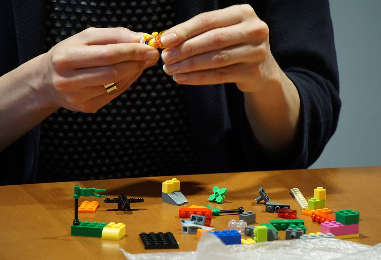 Woman with Lego figure in her hands