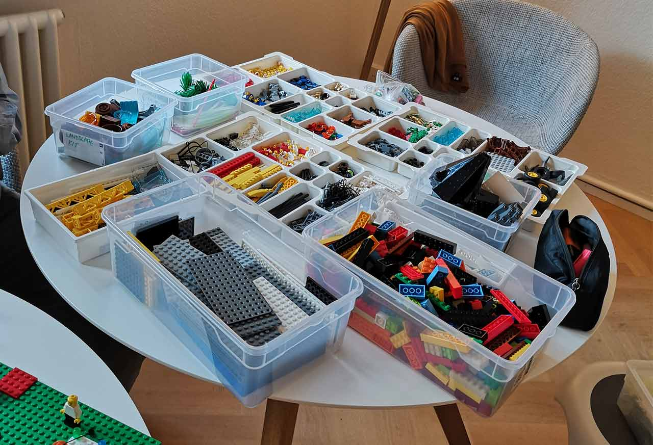 Lego Serious Play building blocks in boxes on a table
