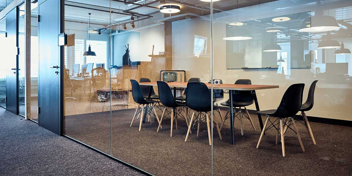 Meeting room with glass wall, table and chairs